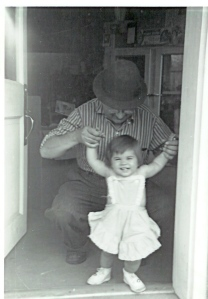 My grandfather and me in the door of his florist shop