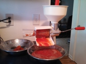 Crushing tomatoes with food mill