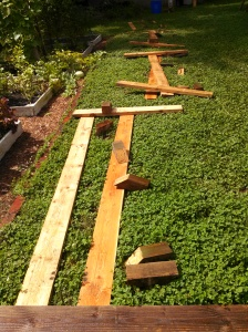 New raised bed pieces laid out for assembly