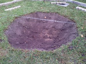 Dug out firepit center with measuring lines