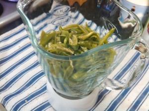 Cut green peppers in blender