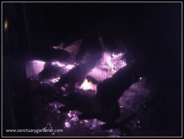 Reverse Fire Building ~ the last of the logs burning