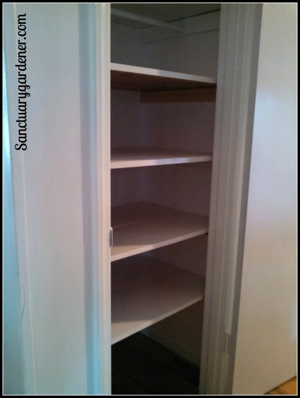 Coat closet transformed into a new pantry