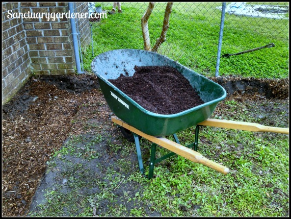 Mixing the new soil for the L Garden