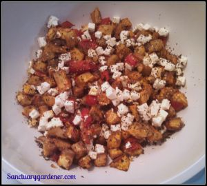 Roasted eggplant and tomatoes mixed with feta