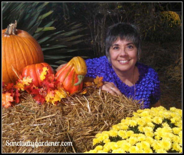 Me with a fall arrangement in the garden area